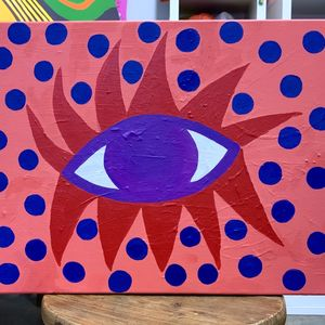 A painting of an eye with a pink background and blue dots surrounding it
