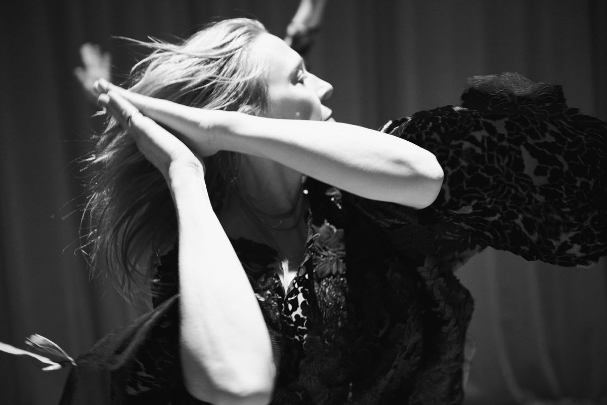 Black and white photograph of Jo Lloyd dancing - movement