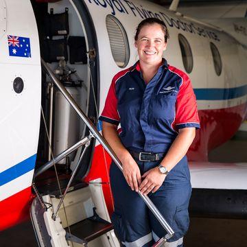 Female pilot in uniform smiling