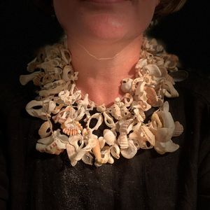 Melinda Young wears a necklace made of shells and other found materials