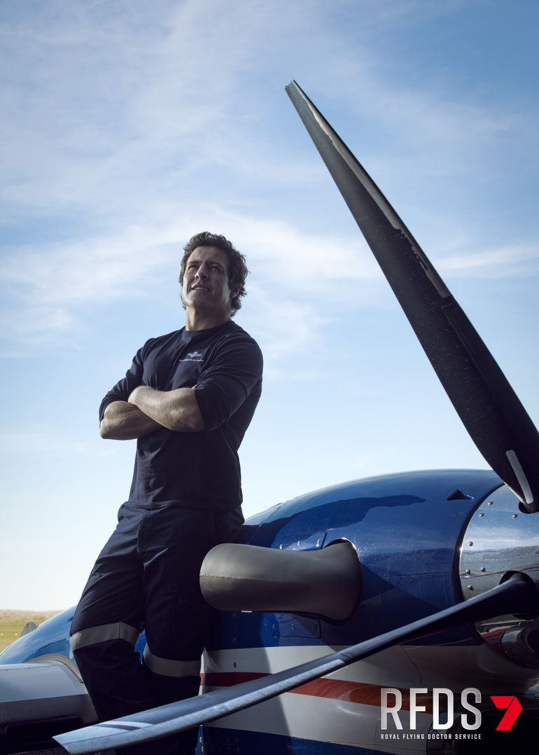 Stephen Peacocke in front of a plane