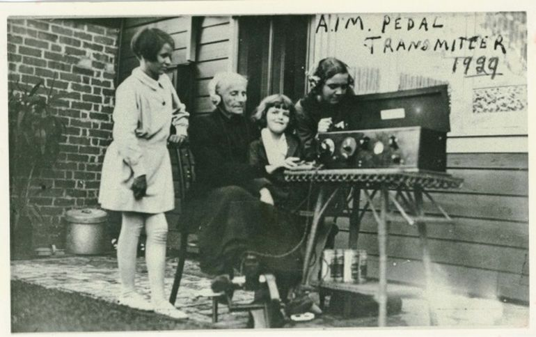 Lady using the pedal radio in 1929