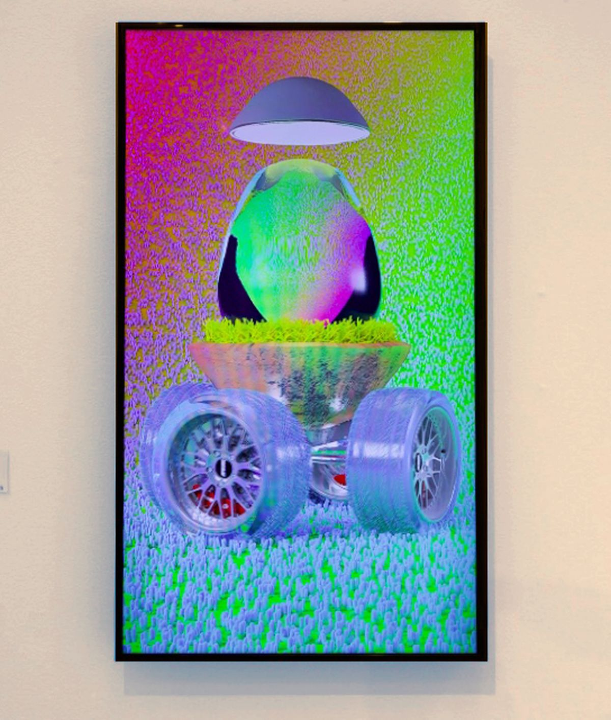 photo of a video screen showing a picture of a colourful egg on wheels