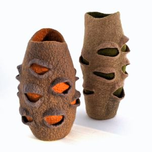Two felted vessels shaped like banksia pods standing side by side.