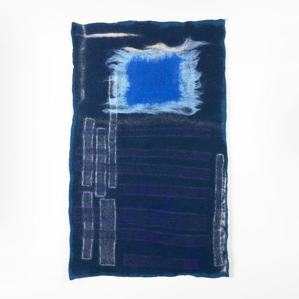 indigo blue dyed fabric with embroidered embellishments