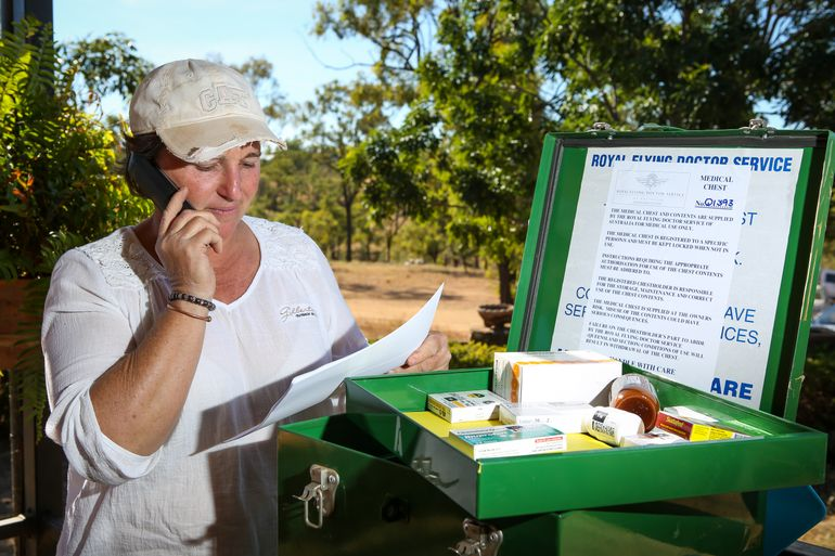 A lady in remote Queensland using a medical chest