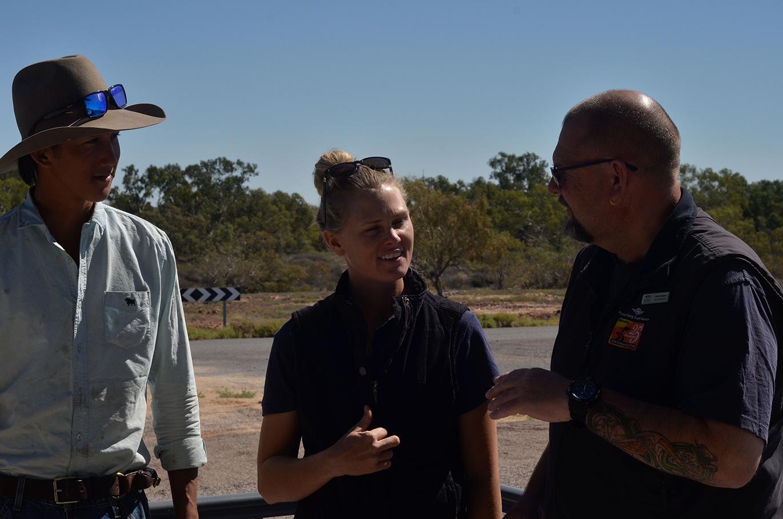 Innamincka station farm hand Josiah Bradley and stock manager Tegan Hall speak to Nurse Practitioner Chris Belshaw