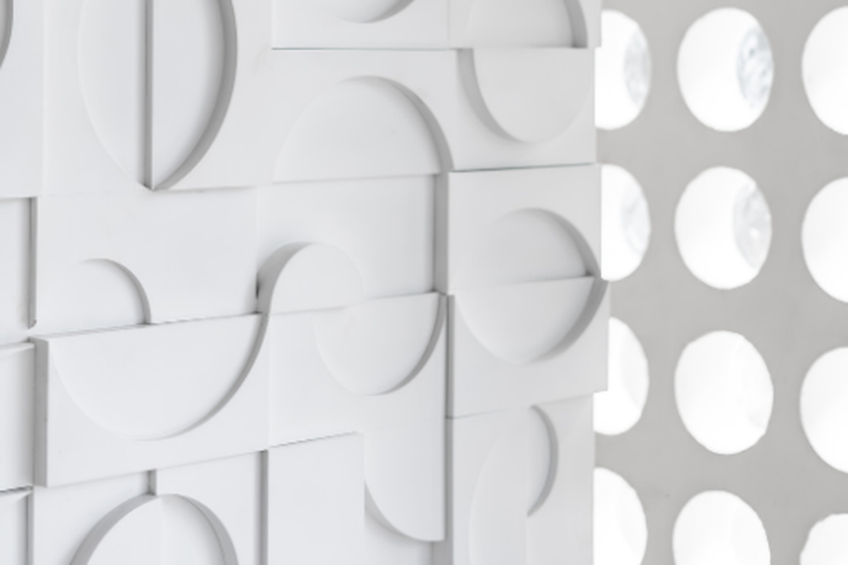 White wall with geometric shapes