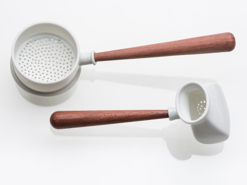 Prue Venables. Pair of white tea strainers with wooden handles. 2017.